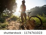 young woman cyclist carrying... | Shutterstock . vector #1176761023