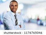 smiling handsome businessman... | Shutterstock . vector #1176765046