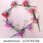 love wooden word  with fresh... | Shutterstock . vector #1176765766