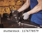 strong hands hold the steel... | Shutterstock . vector #1176778579