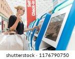 casual caucasian woman using... | Shutterstock . vector #1176790750