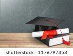 graduation mortarboard on  book ... | Shutterstock . vector #1176797353