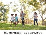 family running through park... | Shutterstock . vector #1176842539