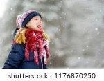 adorable little girl catching... | Shutterstock . vector #1176870250