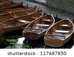 Rowing Boats Moored On A River...