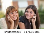 two young women with mobile...