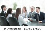 business team holds a workshop... | Shutterstock . vector #1176917590