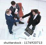 top view.handshake business...   Shutterstock . vector #1176920713