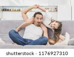 father playing with daughter at ... | Shutterstock . vector #1176927310