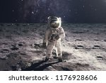 astronaut on rock surface with... | Shutterstock . vector #1176928606