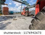 two red forklifts in container... | Shutterstock . vector #1176942673
