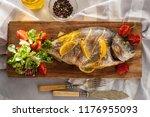 grilled dorado with lemon ... | Shutterstock . vector #1176955093