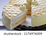 cake with milk powder coating | Shutterstock . vector #1176976009