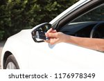 woman's hand presses button on... | Shutterstock . vector #1176978349