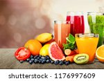tasty fruits and juice with...   Shutterstock . vector #1176997609
