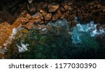 aerial view of waves  rocks and ... | Shutterstock . vector #1177030390