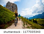 couple cycling in cortina d... | Shutterstock . vector #1177035343