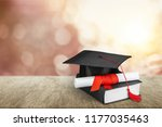graduation mortarboard on  book ... | Shutterstock . vector #1177035463