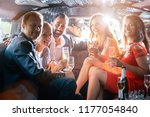 group of party people in a limo ... | Shutterstock . vector #1177054840