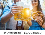 couple toasting with beer in... | Shutterstock . vector #1177055080