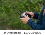 man piloting drone   Shutterstock . vector #1177084003