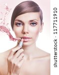 natural woman with pink lipstick and splash - stock photo