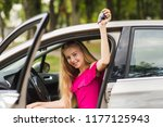 young female driver demonstrate ... | Shutterstock . vector #1177125943