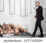 speaker conducts the business... | Shutterstock . vector #1177135039