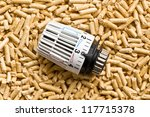 the wooden pellets with thermostat - stock photo