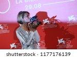 natalya kudryashova poses with... | Shutterstock . vector #1177176139