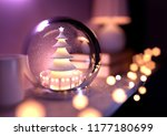 a christmas tree snow globe on... | Shutterstock . vector #1177180699