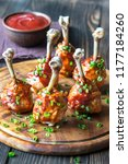 chicken drumsticks in barbecue... | Shutterstock . vector #1177184260