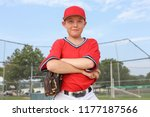 boy pitcher smiling and holding ...   Shutterstock . vector #1177187566