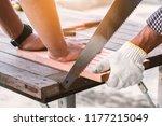 carpenter man sawing a wood in... | Shutterstock . vector #1177215049