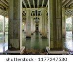 a river flowing under a bridge...   Shutterstock . vector #1177247530