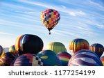 A Rising Hot Air Balloon While...