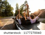ompany of young people riding... | Shutterstock . vector #1177270060