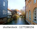 homes flanking an estuary of... | Shutterstock . vector #1177288156