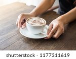 close up of woman hands holding ... | Shutterstock . vector #1177311619
