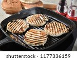 salmon burgers cooking in a... | Shutterstock . vector #1177336159