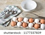 a carton of white and brown... | Shutterstock . vector #1177337839