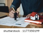 man confirm mortgage contract ... | Shutterstock . vector #1177350199