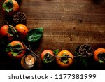 persimmons with candle light | Shutterstock . vector #1177381999