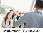 speaker talking in seminar with ... | Shutterstock . vector #1177387030