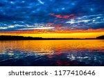 sunset forest lake reflection... | Shutterstock . vector #1177410646