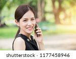 Business Girl Calling Outdoor...
