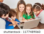 students have fun at laptop pc... | Shutterstock . vector #1177489060