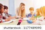 group of children doing... | Shutterstock . vector #1177489090