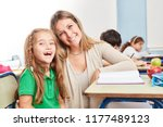 happy girl as a student with... | Shutterstock . vector #1177489123
