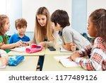 woman as a teacher helps with... | Shutterstock . vector #1177489126